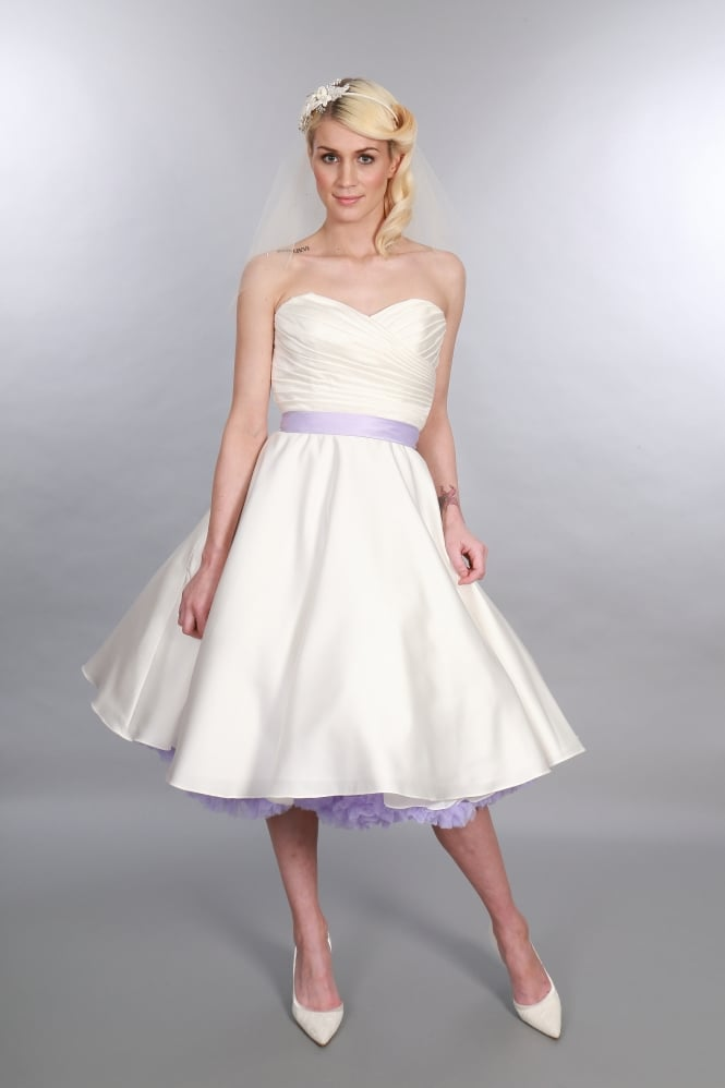 Fantastic short wedding dress, Elizabeth. When choosing wedding colours this is great to accent the colours in the sash and petticoats