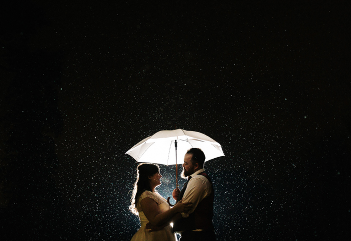 Dancing in the rain on your wedding day. Amazing Bridal gown from Cutting Edge Brides