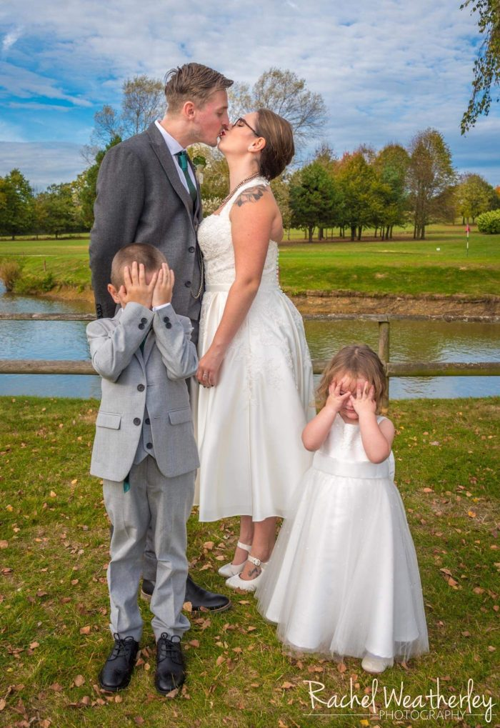 Real Bride Jemma wearing Timeless Chic halter neck wedding dress. Children at weddings can result in some cute photos