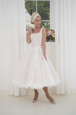 576f34dfd16ef4 Elegant strapless short calf length wedding dress in our famous spot tulle!  A pure couture-inspired wedding dress, Delphine has a finely pleated bodice  in a ...