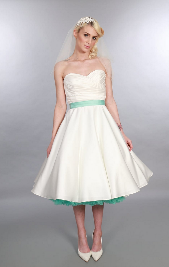 Elizabeth by Timeless Chic at Cutting Edge Brides. Ideas on how to accessorize your tea length wedding dress