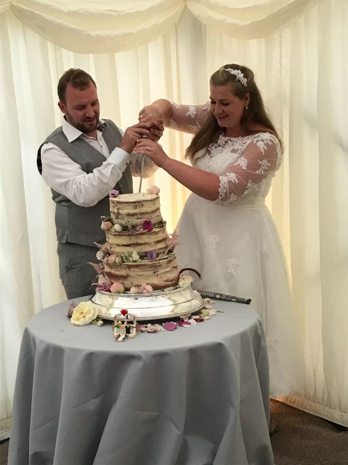 Megan and John real wedding bride wearing calf length wedding dress