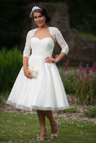 a beautiful tea length wedding dress by Timeless Chic