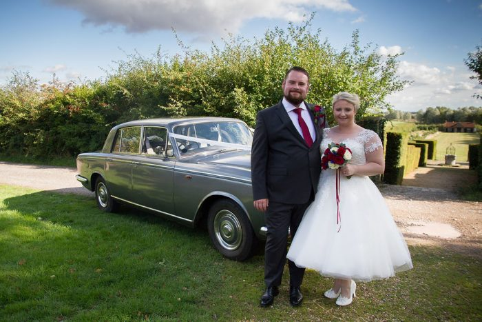 1950s short wedding dress by Cutting Edge Brides. Bride and Groom by vintage style wedding car