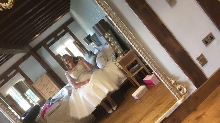 Bride in calf length wedding dress