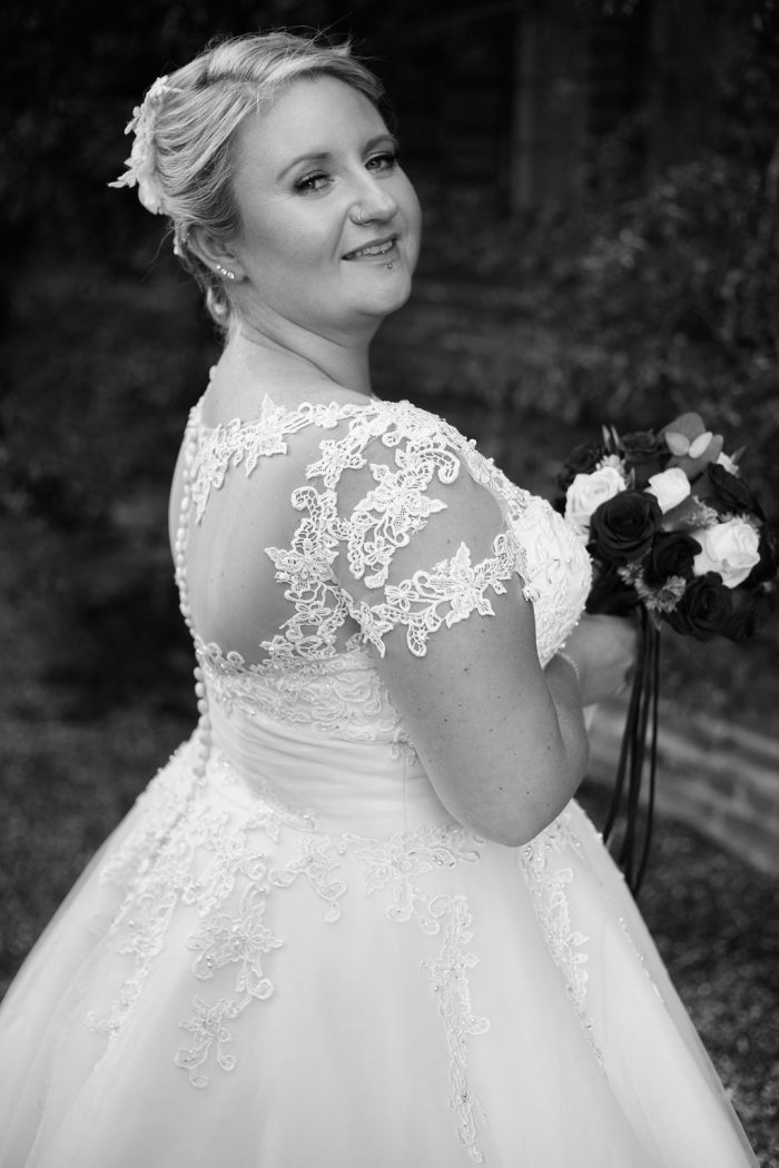 Steph wearing Demi by True Bride. A 1950s short wedding dress style with a full skirt and beaded bodice
