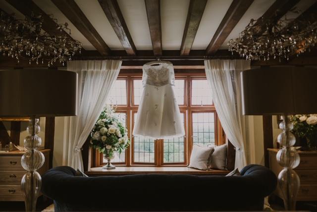 Megans Timeless Chic calf length wedding Dress hung up
