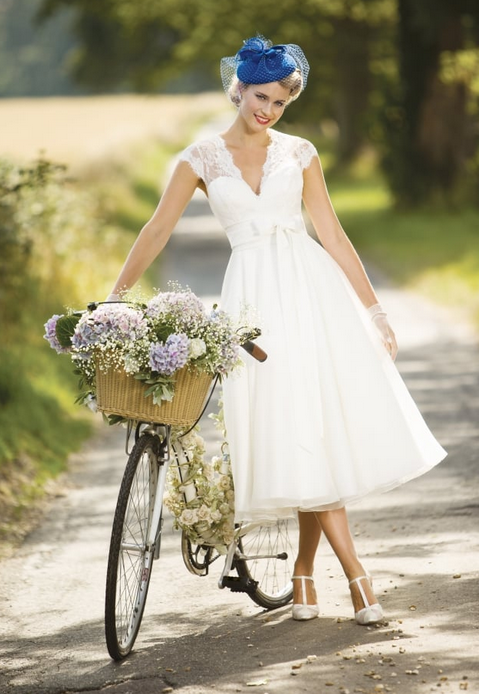 vintage style wedding gown Eva gives a real vintage wedding vibe. Lace and tulle with a dramatic neckline