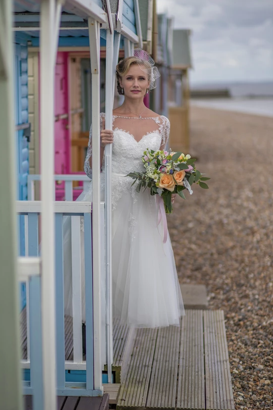 May wedding vintage style seaside shoot featuring Timeless Chic wedding dress