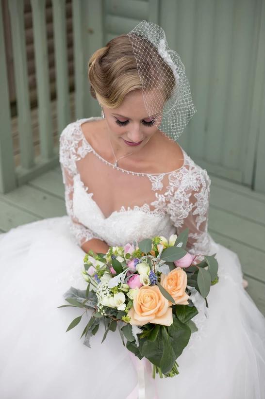 vintage seaside wedding shoot. Bride sitting on beach hut