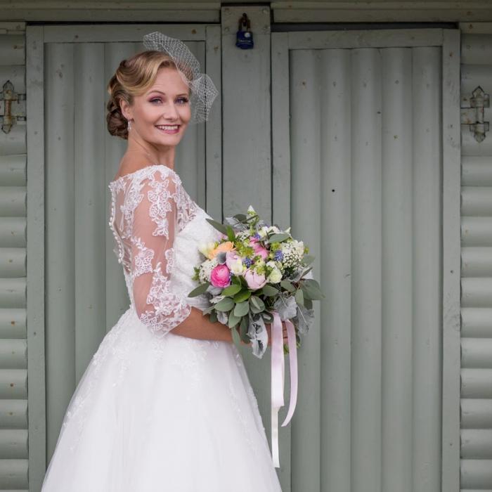 vintage seaside wedding shoot in tea lenght wedding dress