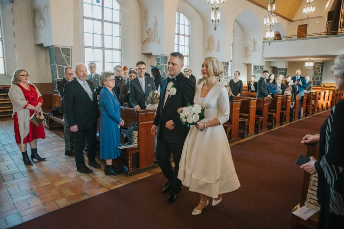 Couple getting married, bride wearing tea length wedding dress