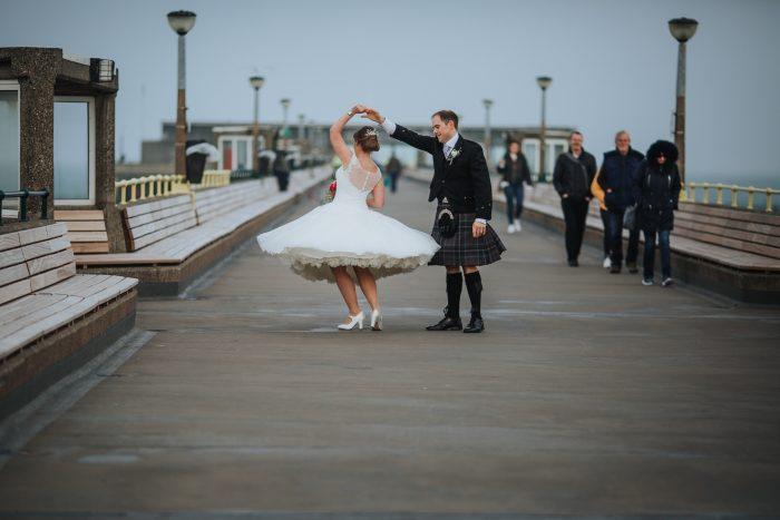 Real Wedding alternative wedding dress on the pier in Deal