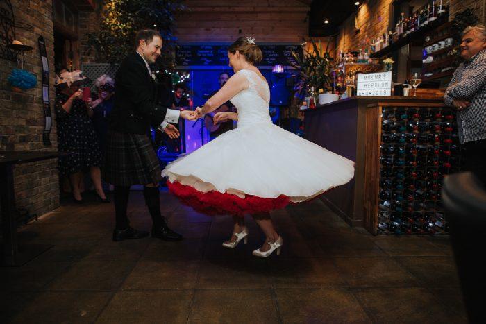 dancing bride in short wedding dress