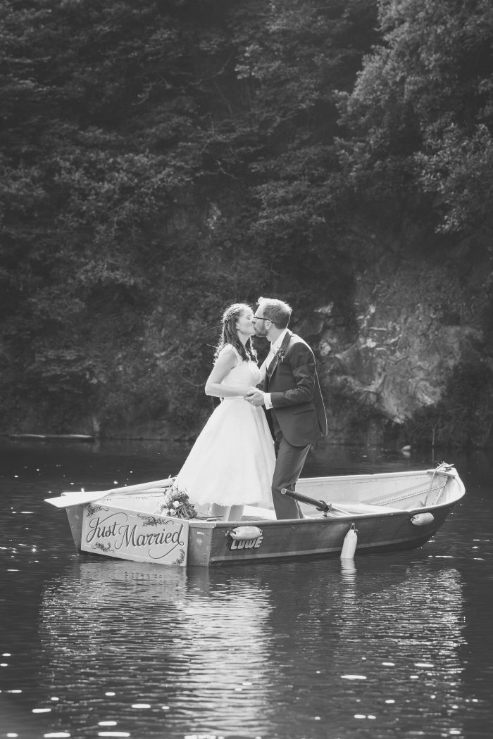 Bride and groom on a lake - Cutting Edge Brides short wedding dress