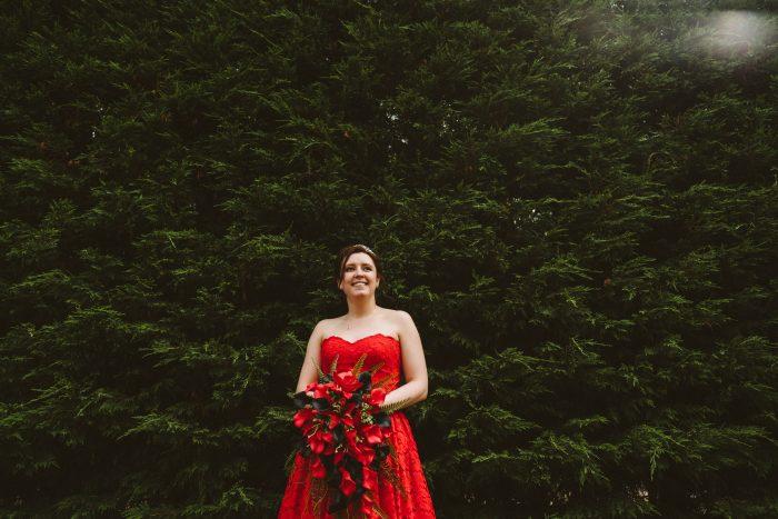 Bride wearing strapless short red wedding dress