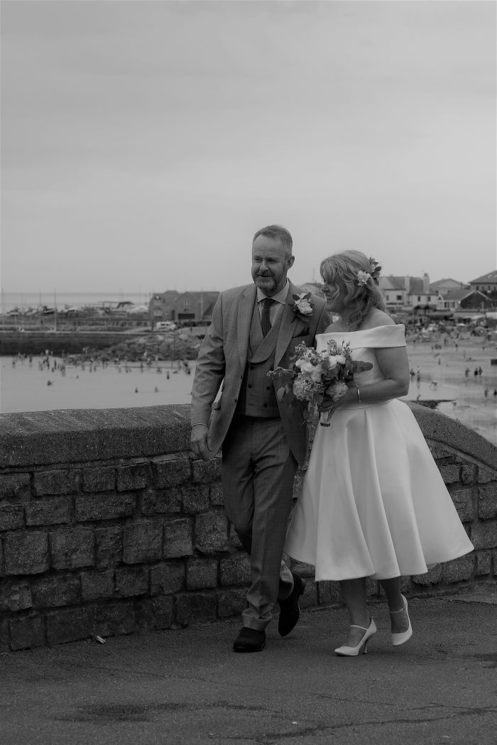 Real wedding in Lyme Regis - Bride wearing a tea length wedding dress