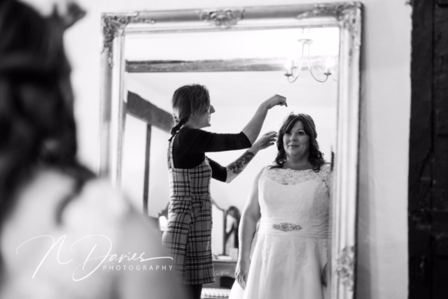Bride to be getting ready wearing a Cutting Edge Brides wedding dress