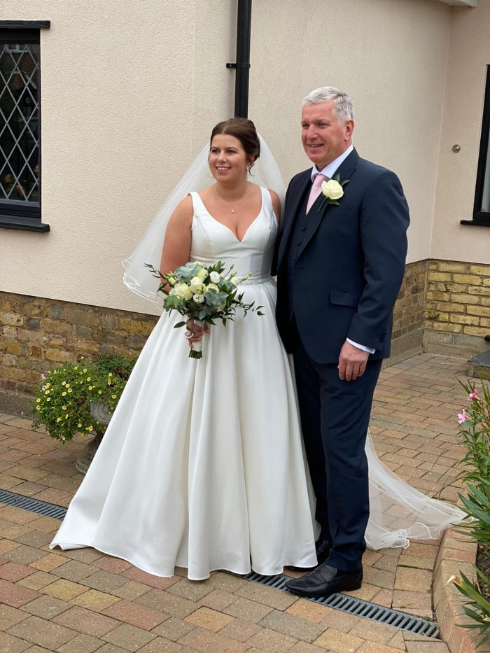 Rebecca and her dad - rebecca wearing a satin wedding gown