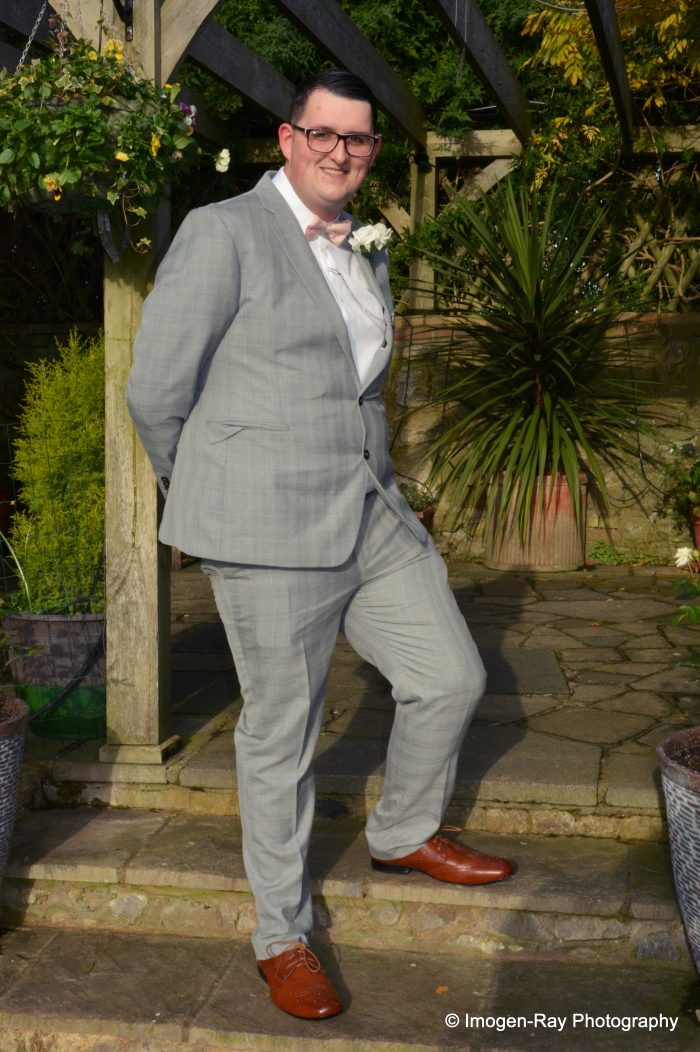 Groom wearing a grey suit. Real Wedding from Cutting Edge Brides