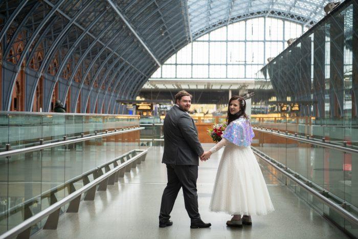 Bride and groom - lockdown wedding. Tea length wedding dress