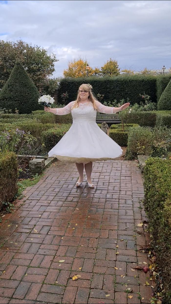 Kaylee wearing her dream short wedding dress