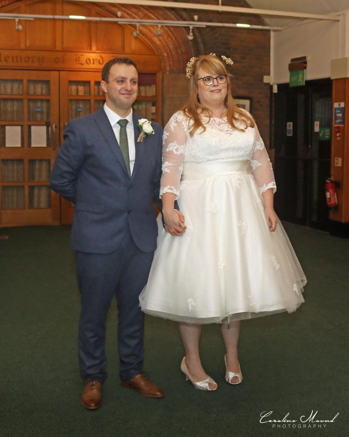 Our real bride and groom at Cutting edge Brides. Bride wearing her dream short wedding dress