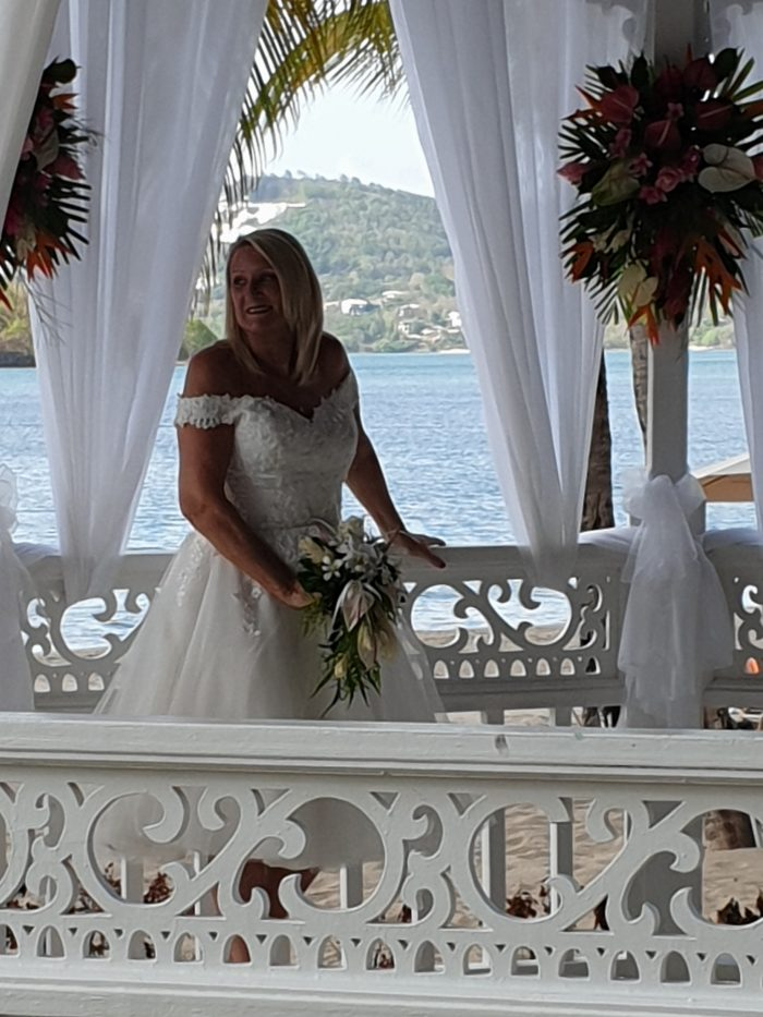Real Bride in St Lucia - wearing a tea length wedding dress from Cutting Edge Brides