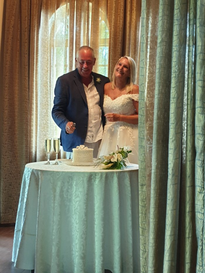 Bride and Groom cutting the cake. Bride wearing Brighton Belle gown from Cutting Edge Brides