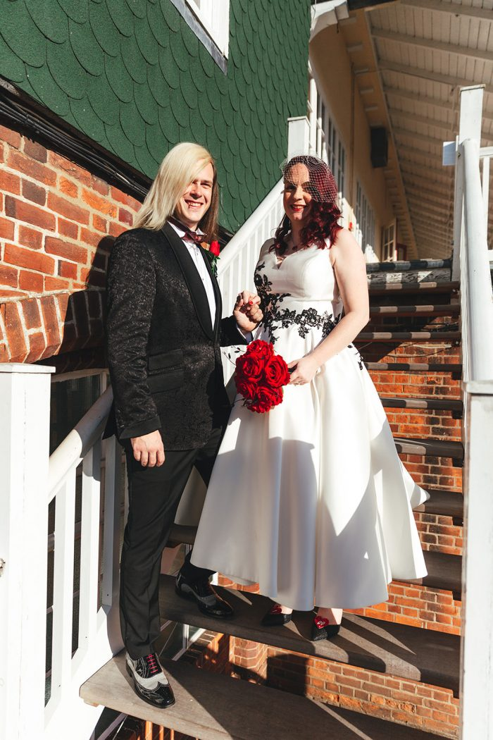 Lois Wild short wedding gown - Bride and groom pictured on stairs
