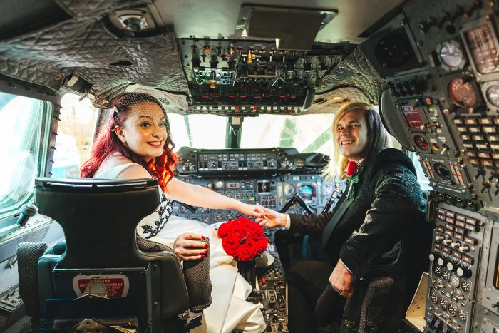 Bride and groom in cockpit of concorde. Real Wedding with Cutting Edge Brides
