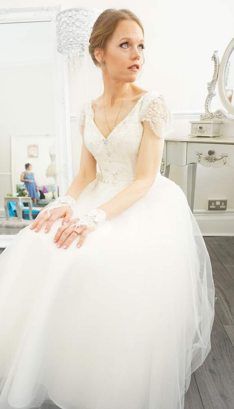 Amy wearing vintage inspired short wedding gown. Tulle and crystal covered tea length wedding dress.