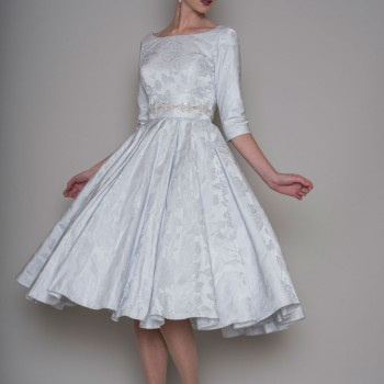 Short wedding dress perfect for a winter wedding by Lou lou bridal at Cutting Edge Brides