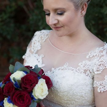 Steph and Harrys wedding with cutting edge brides. Bride with claret flowers