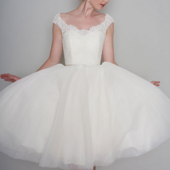 FLOSSIE, tea length vintage inspired lace and tulle dress trimmed with a satin bow belt