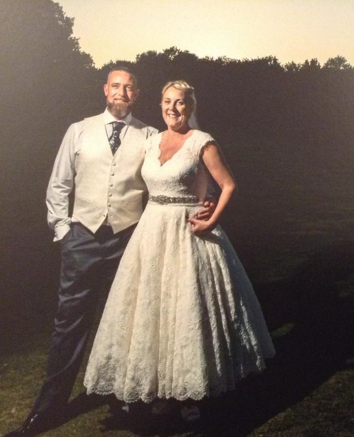 real wedding wearing a calf length vintage inspired wedding dress