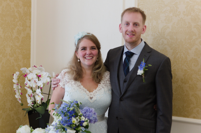 Bride in blue wedding dress from Cutting Edge Brides