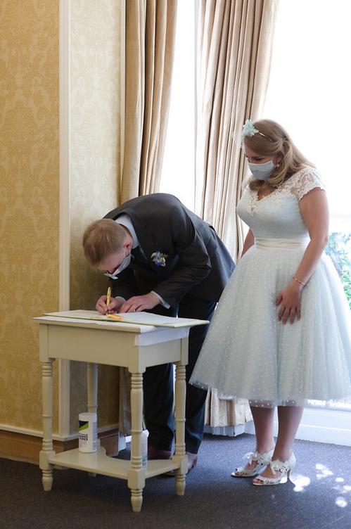 Beautiful blue tea length wedding dress from Cutting Edge Brides