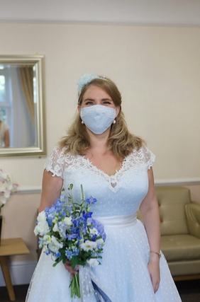 Bride wearing Loulou Bridal blue short wedding dress from Cutting Edge Brides