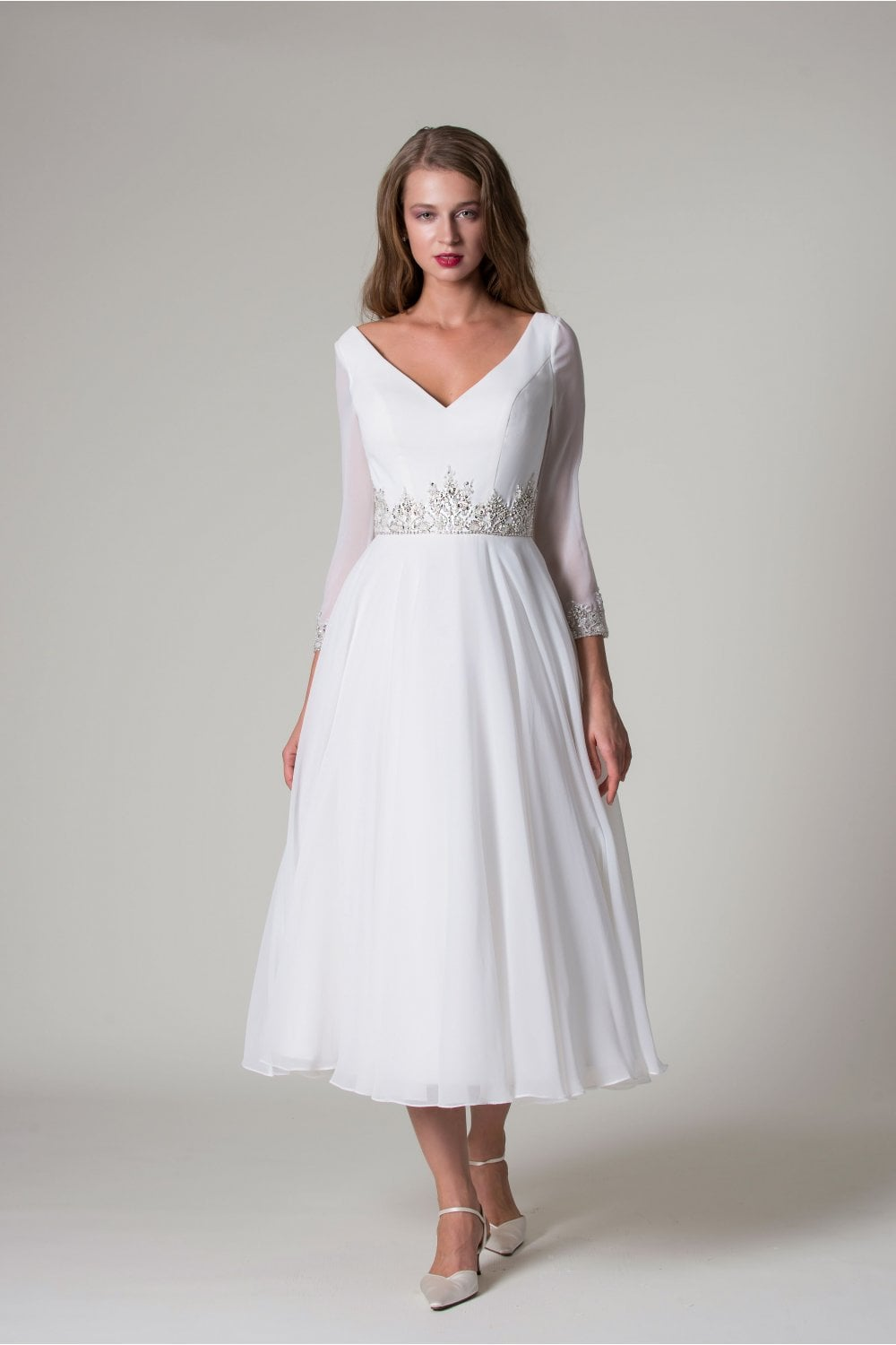 Laia Is A Stylish Long Sleeved Ivory Wedding Dress With A Chiffon Skirt And Sparkle Embellishment